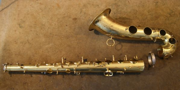 Disassembled saxophone body for cleaning, dents repair & complete springs replacement